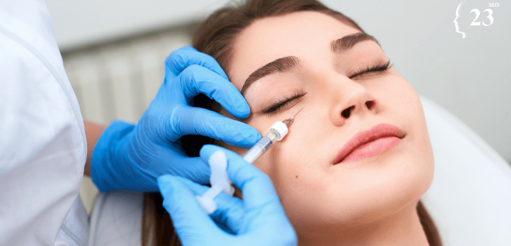 woman having under eye treatment to reduce dark circles